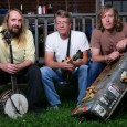 Split Lip Rayfield is often described as a mix of bluegrass and country with an accent of metal.  No other band delivers the experience of the homemade gas-tank bass, mandolin, and banjo. Together, these three men burn up speakers and stages alike as they tour and play music for the fan faithful.  Mando player Wayne Gottstine recently took some time to share with us at Listen Up Denver! about the documentary Never Make it Home, The Split Livers, Wakarusa, and why we should come out and see them this weekend.
