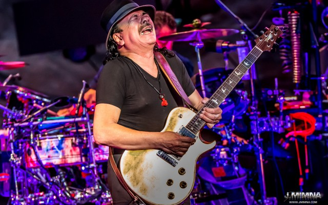 "Carlos Santana played Red Rocks last Monday like he has so many times before.  Billed as ""A Night with Carlos Santana,"" the overcast, wet night was filled with the hits, giant guitar solos, and the epic American songs that define Santana's legacy.  The night was truly a treat for fans and Carlos alike, as his love of the hallowed venue is no secret as he elaborated in his forward written for the new book Red Rocks - The Concert Years by G. Brown."