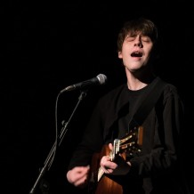 Humbly deflecting unasked-for requests for songs, English songwriter Jake Bugg guided a packed house through a memorable acoustic set last Tuesday night at the Bluebird. Bugg's set, though acoustic and played primarily under a single spotlight, was by no means dull. The twenty-four-year-old was preceded by another young UK musician, Scotland's Nina Nesbitt.